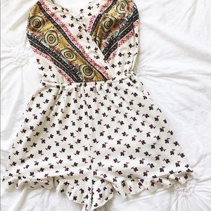 White romper with design